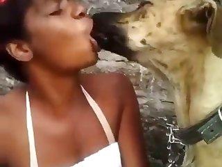 Black Woman Kissing Dog